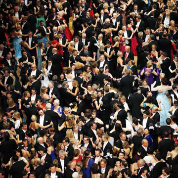 Image: Visitors dance at the Opera Ball in Vienna