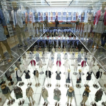 Mannequins are displayed at Fast Retailing's flagship Uniqlo store in Tokyo