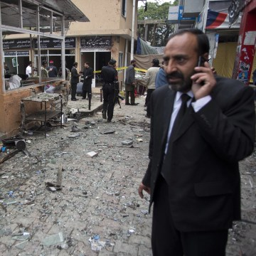 Image: A lawyer at the site of a suicide attack in a court complex in Islamabad on March 3, 2014.