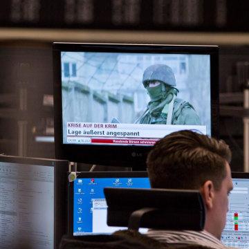 The specter of Russian troops in Crimea hangs over European markets, like here in Frankfurt, Germany.