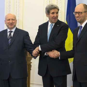 Image: Oleksandr Turchynov, John Kerry and Arseniy Yatsenyuk shake hands Tuesday.
