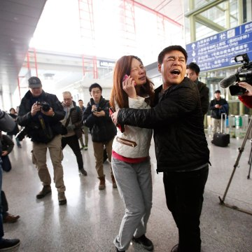 Image: A woman, believed to be the relative of a passenger onboard Malaysia Airlines flight MH370, cries at the Beijing Capital International Airport