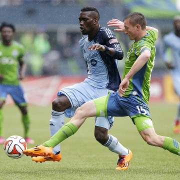 Image: Seattle Sounders' Dylan Remick, right, battles for the ball with Sporting Kansas City's C.J. Sapong, second from right, in the first half of an MLS soccer match, on March 8, 2014, in Seattle.