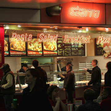Customers order lunch at a Sbarro restaurant in Chicago. The pizza chain filed for Chapter 11 bankruptcy protection on Monday, for the second time in less than three years.