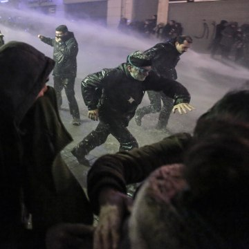 Image: Riot police use water cannons to disperse people protesting the death of Berkin Elvan