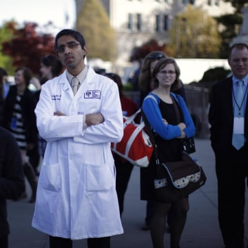 Image: Doctor Murthy stands outside the Supreme Court during legal arguments over the Affordable Care Act in Washington