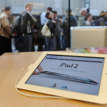 Customers wait to buy the new Apple iPad