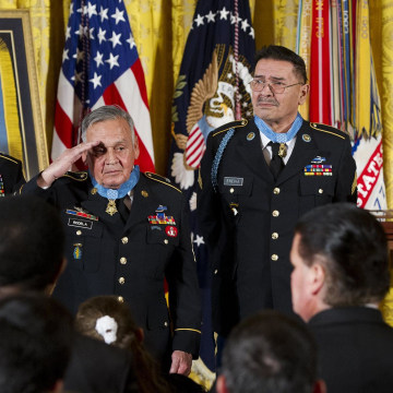 Image: President Barack Obama applauds Medal of Honor recipients Staff Sergeant Melvin Morris, left, Sergeant First Class Jose Rodela, second left, and Specialist Four Santiago Erevia, third left, for actions during the Vietnam War, during a ceremony in t