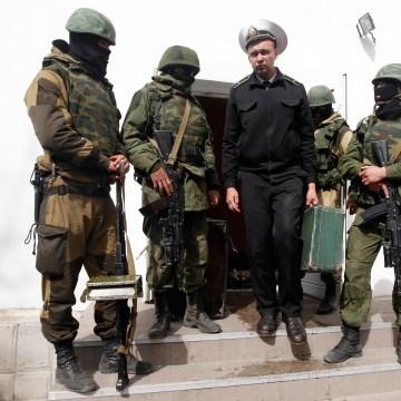 Image: A Ukrainian naval officer leaves the naval headquarters in Sevastopol