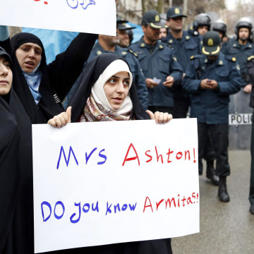 Image: Students protest in Tehran on March 12 to condemn a meeting between Catherine Ashton and Iranian dissidents