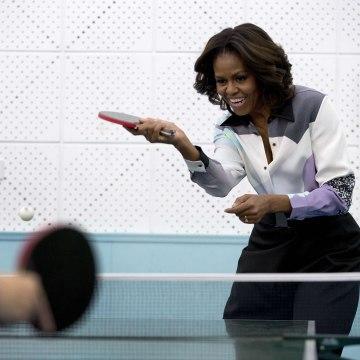 Image: First Lady Michelle Obama plays table tennis