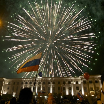 Image: People watch fireworks at the central Lenin square in Simferopol, Crimea