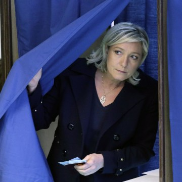 Image: France's far-right National Front political party leader Marine Le Pen leaves a polling booth as she votes during the first round in the French mayoral elections in Henin Beaumont