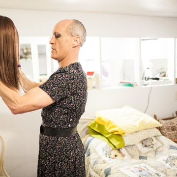 Image: Karen Scot prepares her wig before her first day teaching as a transgendered woman