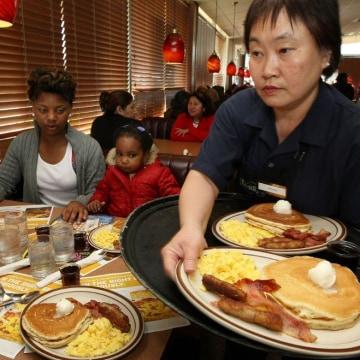 Denny's waiter serves breakfast
