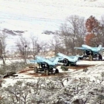 Image: North Korean TV shows drone planes during a drill in March 2013.