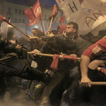 Image: Protesters clash with riot police during a protest in Athens