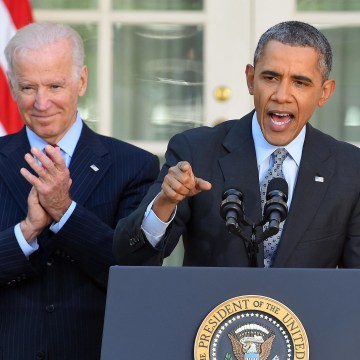 Image: U.S. President Barack Obama is accompanied by Vice President Joe Biden as he delivers a statement on the Affordable Care Act