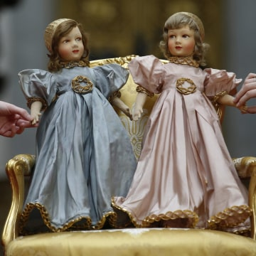 Image: A pair of Parisian dolls belonging to Britain's Queen Elizabeth and her sister Princess Margaret, are seen at Buckingham Palace in London