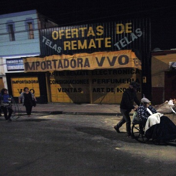 Image: A man is pushed in a wheelchair to a safety area after a strong aftershock in Arica, Chile, early Thursday, April 3