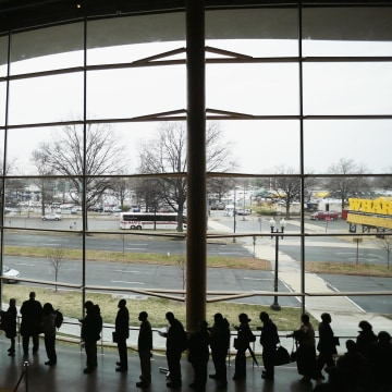 About 1,500 people seeking employment wait in line to enter a job fair at the Arena Stage at the Mead Center for American Theater March 28, 2014 in Washington, DC.