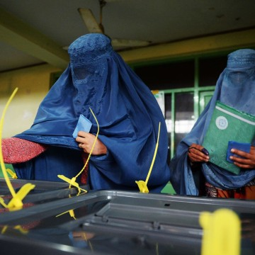 Image: Afghan women cast their ballots at a polling station in Kabul