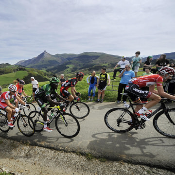 Image: Cyclists climb the Lazkaomendi hill during the first stage of the Tour of the Basque Country in Lazkao, Spain, on Monday.