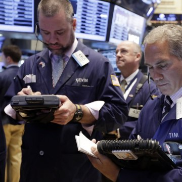 Stocks slumped and the Nasdaq had its worst day in over two years as investors dumped high-priced tech and biotechnology stocks.