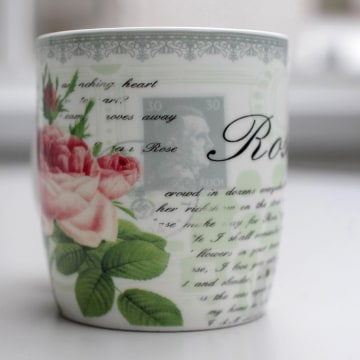 Image: A mug with a print of a faded stamp with a portrait of Nazi dictator Adolf Hitler