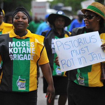 Image: Members of the ruling ANC Women's League march in Pretoria on the anniversary of the killing of Reeva Steenkamp