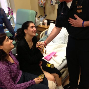Image: Sydney Corcoran meets a first responder who helped her after the Boston Marathon bombing