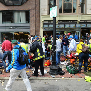 Image: First responders aid those injured by the Boston Marathon bombing