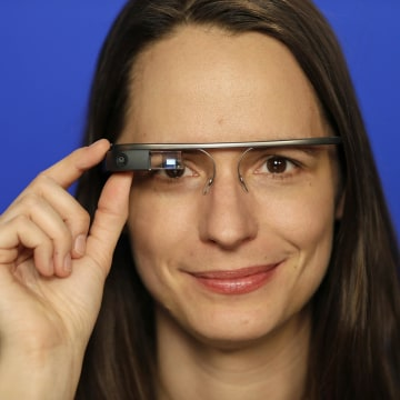 Image: A woman wears Google Glass in New York