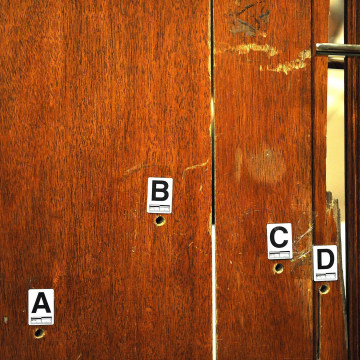 Image: The door through which Reeva Steenkamp was shot, used as evidence and displayed during Oscar Pistorius' murder trial