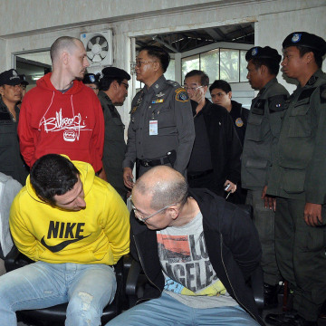 Image: Men suspected of smuggling methamphetamines from North Korea