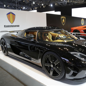 The Koenigsegg Agera R, left, is shown at the New York International Auto Show.