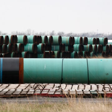 Image: Stacks of pipe are stored at the pipe yard for a component of the Keystone pipeline