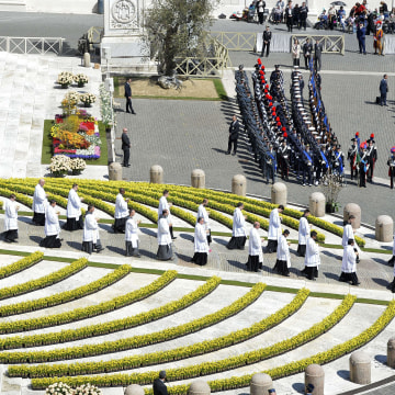 Image: A general view shows flowers on the parvis of St Peter's basilica during the Easter mass on Sunday in the Vatican.