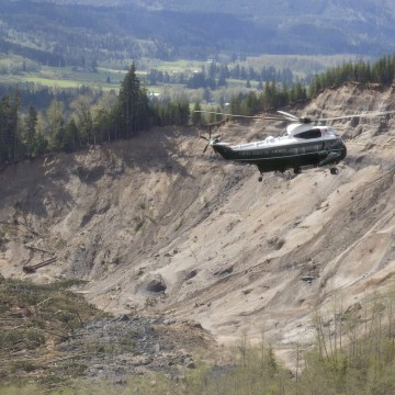 Image: Marine One, carrying U.S. President Barack Obama, takes an aerial tour of Oso, Wash.
