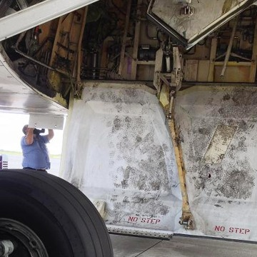 Footprints around the wheel well of a Hawaiian Airlines plane where a teenage stowaway is thought to have clambered aboard.
