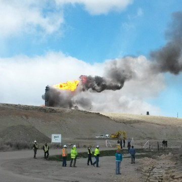 Image: A fire burns after an explosion at a natural gas pipeline hub in Opal, Wyo., on Wednesday, April 23, 2014.