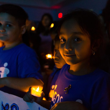Image: Children and parents gathered for a vigil highlighting National Child Abuse Prevention Month in Miami