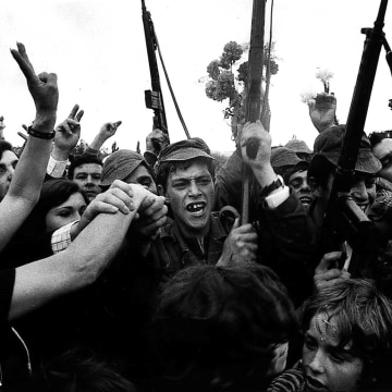 Image: Soldiers and civilians celebrate the victory of the Portuguese military uprising with carnations on April 25, 1974.
