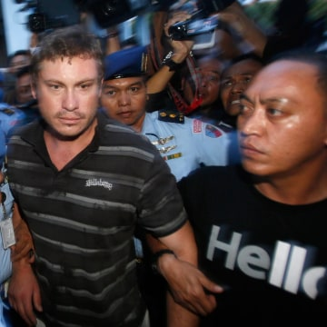 Image: Australian Matt Christopher Lockley is led away by Indonesian military officers