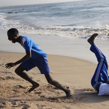 Boys play on the beach in Dakar, Senegal.