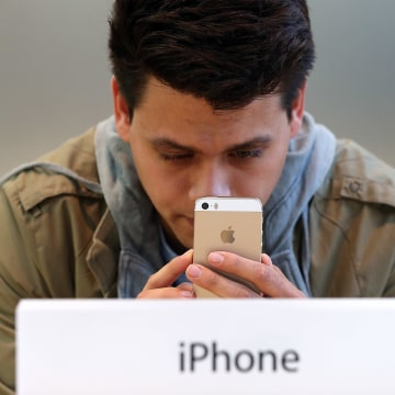 Image: Man looks at iPhone