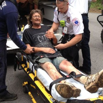 J.R. Kimbler is loaded into an ambulance Tuesday morning after he and his two kids were rescued in Congaree National Park.