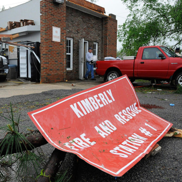 Image: A worker removes items from the wrecked fire station in Kimberly, Ala., on Tuesday.