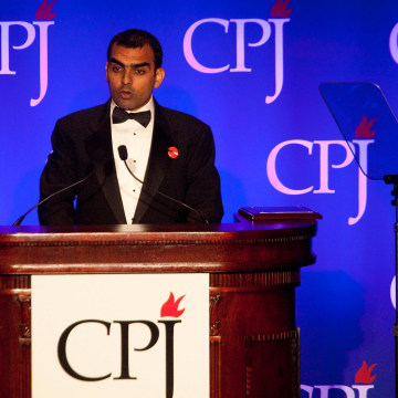Image: Pakistani journalist Umar Cheema accepts the 2011 International Press Freedom award
