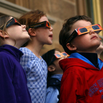 Image: Children wear protective glasses